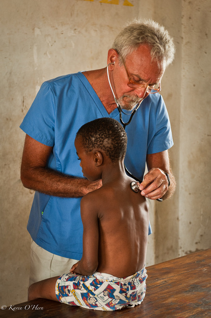 Dr. Keith does full exams on the children